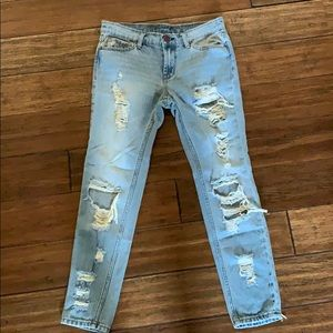 Ripped, light wash denim jeans